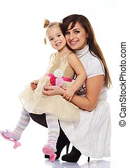 Happy smiling young mother holding her little daughter