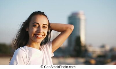 happy smiling young pretty woman in white t-shirt is...