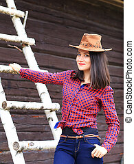 Happy smiling young woman in stetson