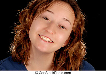 happy smiling young woman on black background
