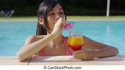 Happy smiling young woman with a fruity cocktail - Happy...