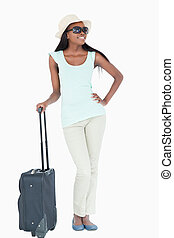 Happy smiling young woman with her suitcase
