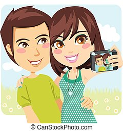 Happy Snapshot - Young happy couple taking a snapshot of...