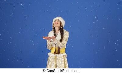 Happy Snow Maiden Enjoying Falling Snow In Studio
