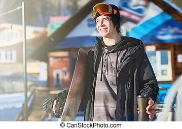Happy Snowboarder at Ski Resort