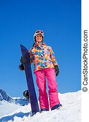 Happy snowboarder woman