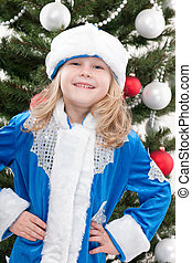Happy Snowmaiden at the christmas tree