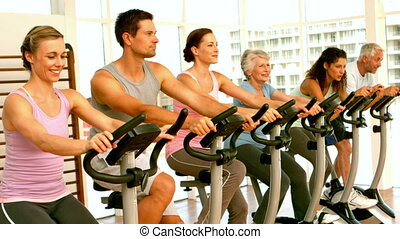 Happy spinning class in fitness st