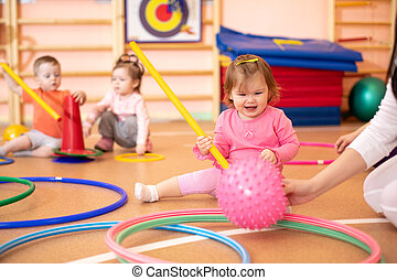 Happy sporty children in nursery gym