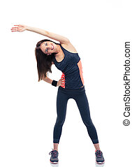 Happy sporty woman doing stretching exercise