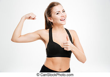 Happy sporty woman showing ok sign with fingers - Happy ...