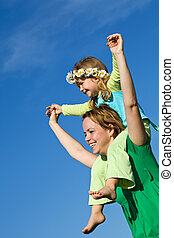 Happy spring girls against blue sky