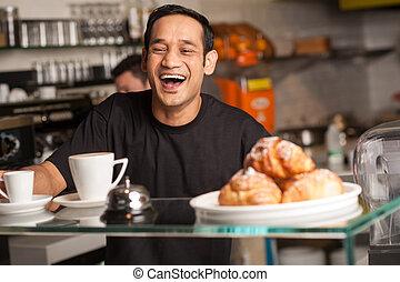 Happy staff at restaurant