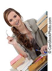 Happy student doing homework
