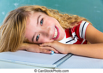Happy student expression schoolgirl in classroom