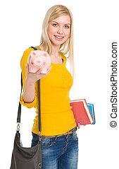 Happy student girl showing piggy bank