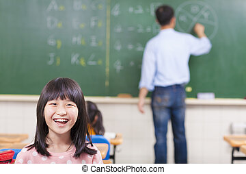 happy student in class with teacher