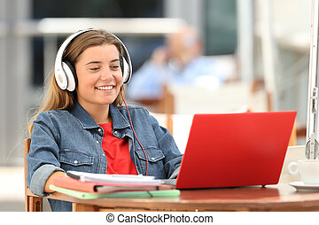 Happy student relaxing watching on line content
