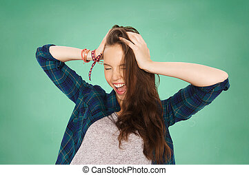 happy student teenage girl holding to head