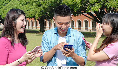 happy student use phone in the school