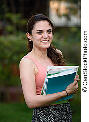 Happy student with notebooks