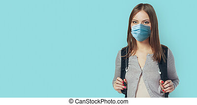 Happy student woman in mask