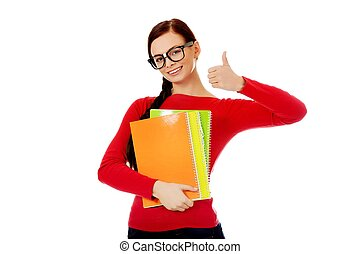 Happy student woman with thumb up