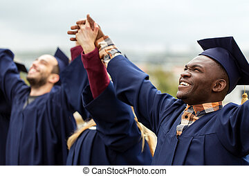 happy students celebrating graduation