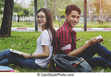 Happy students couple sitting together at university