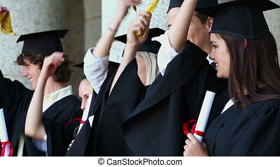 Happy students holding their tassels