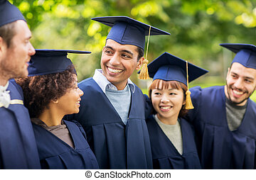 happy students or bachelors in mortar boards - education,...
