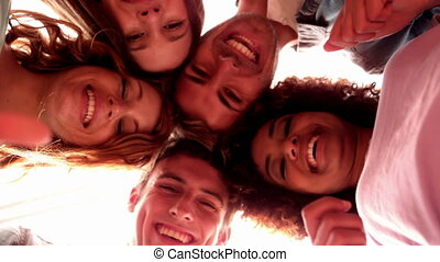 Happy students standing in circle