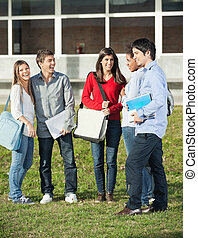 Happy Students Standing On College Campus