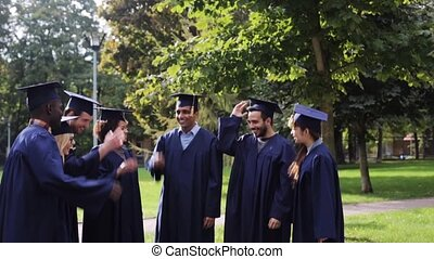 happy students throwing mortar boards up - education, ...