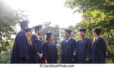 happy students throwing mortar boards up