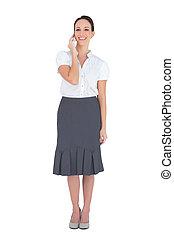Happy stylish businesswoman on the phone