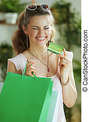 happy stylish woman shopper in blouse with bags