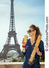 happy stylish woman with baguette drinking coffee