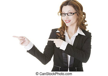 Happy success business woman pointing