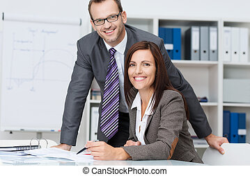 Happy successful business team or partners with a smiling...