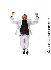 Happy successful businessman jumping