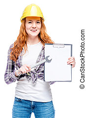 Happy successful woman in the yellow helmet with a key and...