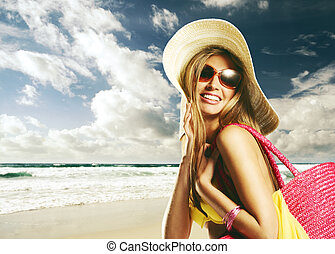 Happy summer holiday - Beautiful young woman on the beach