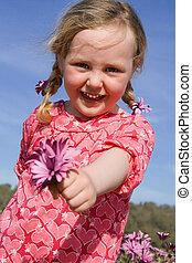 happy summer kid giving gift of flower