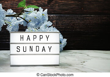 Happy Sunday word in light box with Flowers Decoration
