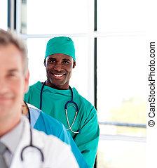 Happy surgeon smiling at the camera