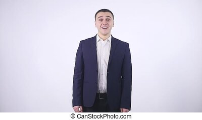 Happy surprised businessman white background