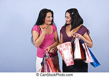 Happy surprised friends at shopping