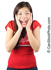 Happy surprised woman very excited holding her head in amazement while looking at the camera. Beautiful mixed race caucasian / asian model. Isolated on white background.