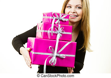 Happy surprised woman with many gifts